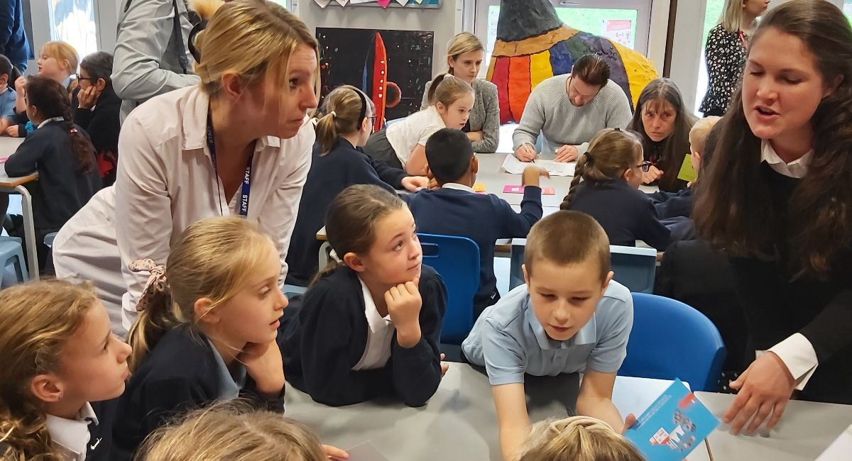 A group of school pupils taking part in a clean air activity in the classroom