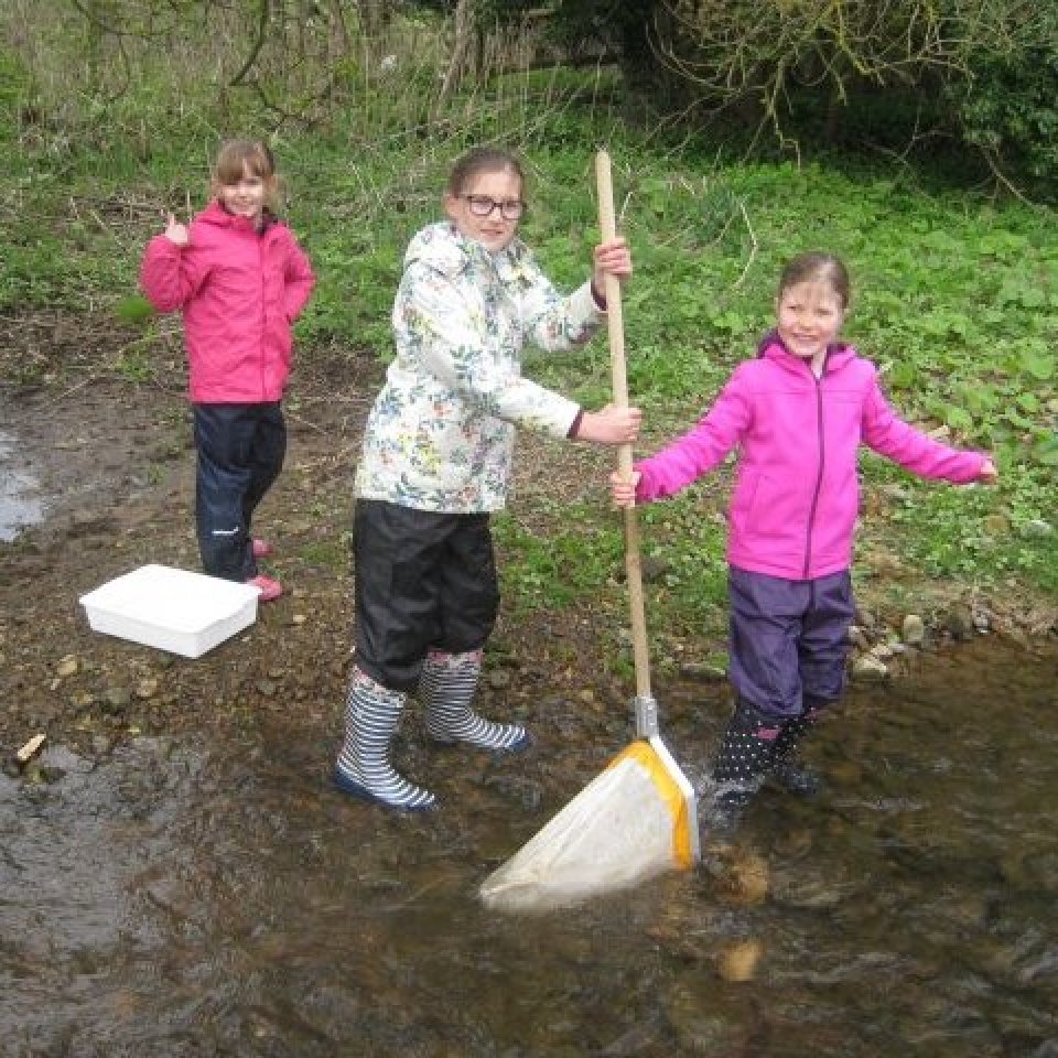 Three young pupils carry out a mini SASS activitiy in the Tyne River