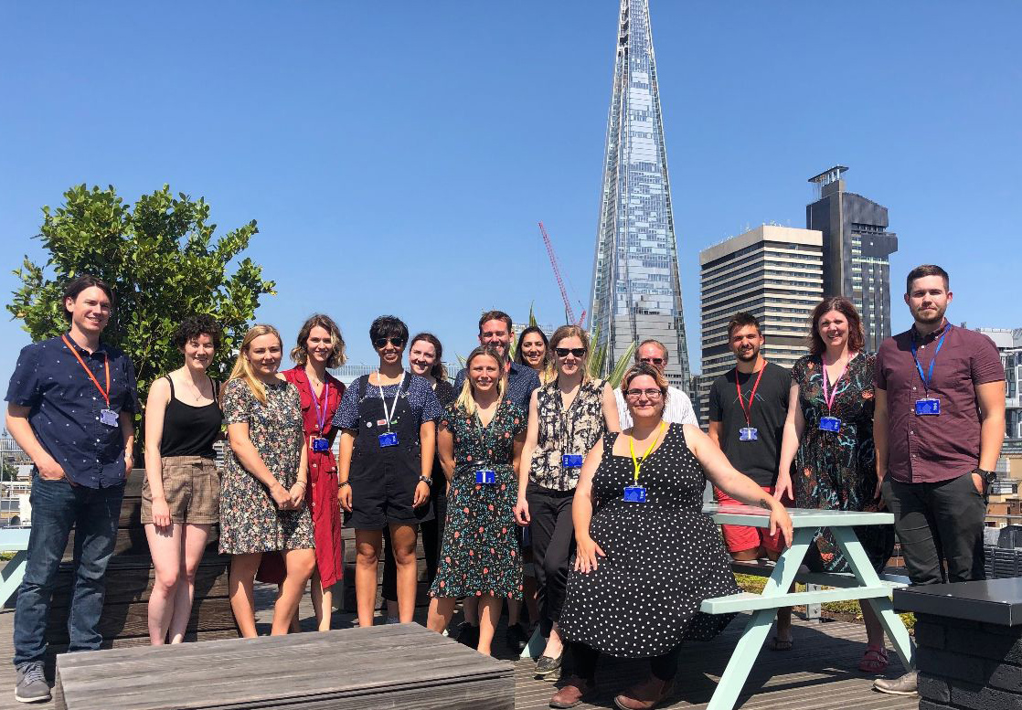 The GAP team on the roof terrace of the new building. It is a sunny day and you can see the Shard building in the background